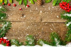 Christmas decoration on a wooden board with snow and rowan Stock Photos