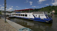 Prague boats on Vltava River's waterfront Stock Footage