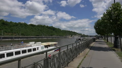 People near boats anchored on the riverside in Prague Stock Footage