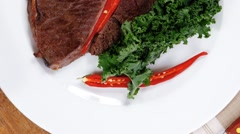 Grilled beef steak fillet meat with red hot pepper Stock Footage