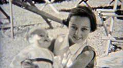 1937: Female schoolmates playing doll outdoor backyard. Stock Footage