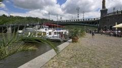 Boat and tourists near Čech Bridge, Prague Stock Footage