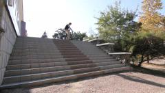 BMX TRICK HUGE 360 over lots of stairs - stock footage