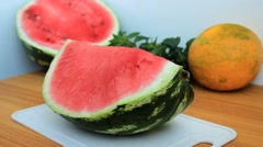 Man's hands cut ripe fragrant watermelon into slices Stock Footage