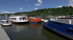 Beautiful boats on Vltava River's waterfront Stock Footage