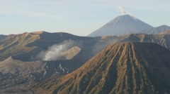 Steaming Bromo volcano at sunrise,Bromo,Java,Indonesia - stock footage