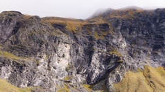 Cliff band in foggy weather, Alps mountains Stock Footage