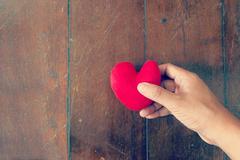 Hand picking  heart Stock Photos