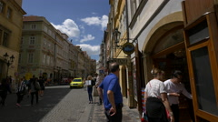 Tourists walking on Mostecka street, Prague Stock Footage