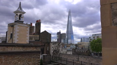 The Shard skyscraper looms over the rooftops of central London, England. - stock footage