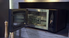 Closing the microwave - stock footage