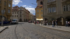 Driving cars near the vintage cars parked in Lesser Town Square, Prague Stock Footage