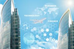 Skyscrapers with computer icons - stock illustration