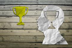 Stock Illustration of Paper humans head with winner cup symbol