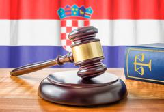 A gavel and a law book - Croatia - stock photo