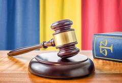A gavel and a law book - Romania - stock photo