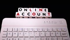 'Online account' on letter dice, with keyboard. - stock footage