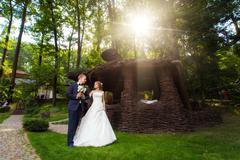 Couple near wooden arbor in park - stock photo