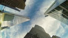 Time-lapse view of skyscrapers and clouds, bottom view - stock footage