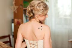 Bride with corset on her dress Stock Photos