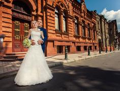 Wedding couple outdoors nearl building - stock photo