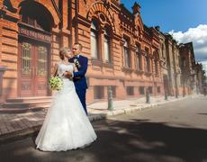 Wedding couple near architectural building - stock photo