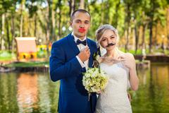 Couple with fine mustache and lips in park - stock photo