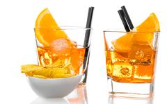 Glasses of spritz aperitif aperol cocktail with orange slices and ice cubes n Stock Photos