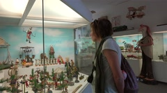 Tourist girl at the showcase of Toy Museum at the Prague Castle. Stock Footage