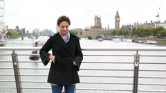 Young woman taking a selfie in London with Thames and Big Ben on background Stock Footage