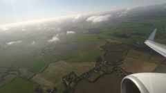 Aerial view of countryside and cloudscape from window seat Stock Footage
