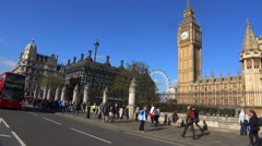Doubledecker bus passing Big Ben and Westminster Abbey, England. - stock footage