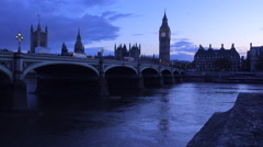 Dusk shot of the River Thames with Big Ben, Parliament and Westminster Abbey - stock footage