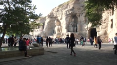 China Datong Yungang Grottoes 12 Crowd near Buddha Stock Footage