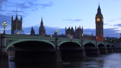 Dusk shot of the River Thames with Big Ben, Parliament and Westminster Abbey Stock Footage