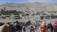Tourists on horses coming from Bromo volcano,Bromo,Java,Indonesia Stock Footage