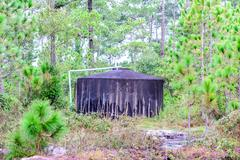 Water tank for plumbing system from cataract in forest. Stock Photos