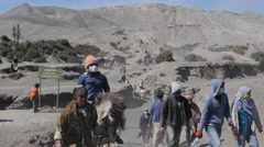 Tourists on horses coming from Bromo volcano,Bromo,Java,Indonesia - stock footage