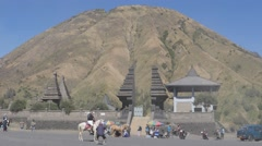 Tourist on horse gets photographed with temple,Bromo,Java,Indonesia Stock Footage