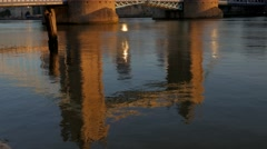 Tilt up Tower Bridge from it's reflection in the River Thames Stock Footage