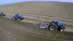 Tillage tractors with Chisel plow.  Aerial shot Stock Footage