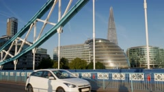 Traffic, cycles and pedestrians crossing Tower Bridge Stock Footage