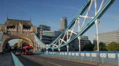 Red London Bus crosses Tower Bridge - stock footage