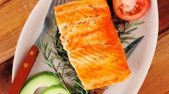 Grilled salmon on glass plate Stock Footage