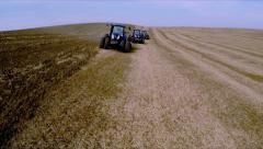Three tractor works the soil with subsoiler. Aerial shot Stock Footage