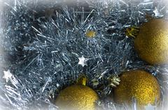 Christmas decorations on a background of shiny tinsel - stock photo