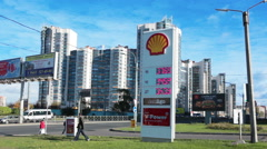 Gas station stand with the cost of petroleum and diesel is in the avenue. Russia Stock Footage
