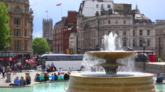 An establishing shot of Trafalgar Square, London England with fountain - stock footage