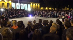 Man and woman perform modern dance surrounded by people audience. 4K Stock Footage