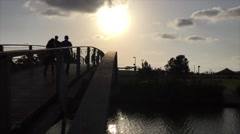 People passing on a bridge Stock Footage
